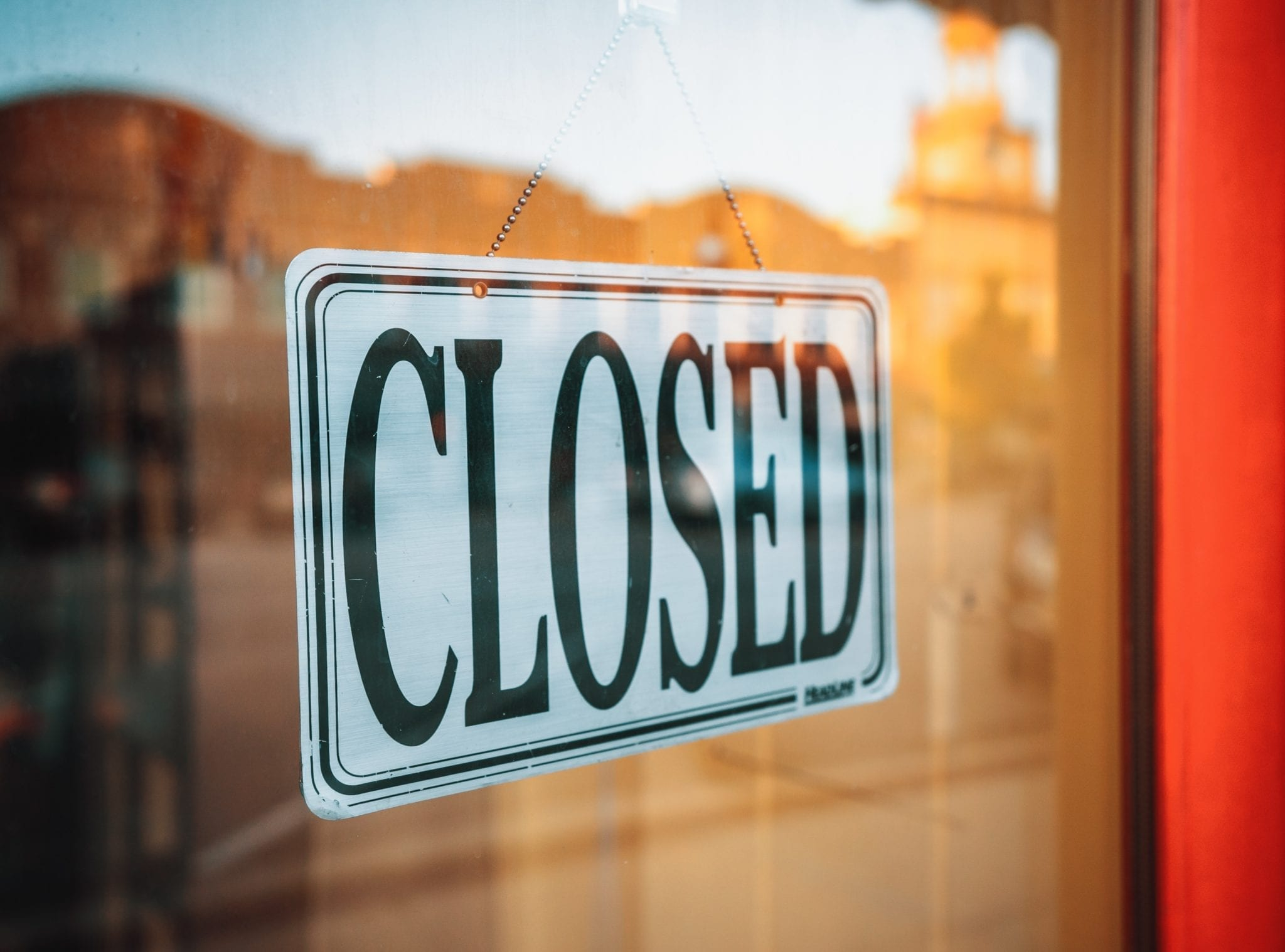 "e-commerce represented by ""closed"" store sign"